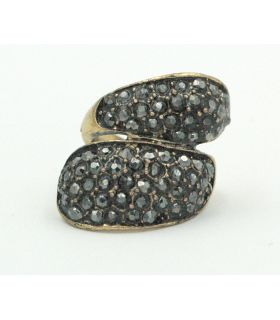 Ring adorned with dark glass stones