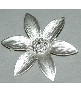 Silver broche with small crystal stones